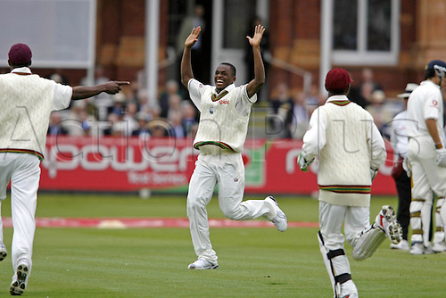 17 May 2007:  West Indies bowler Daren Powell celebrates taking the wicket of Andrew Strauss on day one of the first npower test match between England and West Indies at Lords, London. Photo: Neil Tingle/Actionplus...070517 cricketer cricket player joy celebrations