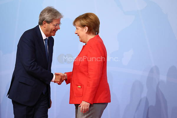 German chancellor Angela Merkel greets the Italian prime minister Paolo Gentiloni at the G20 summit in Hamburg, Germany, 7 July 2017. The heads of the governments of the G20 group of countries are meeting in Hamburg on the 7-8 July 2017. Photo: John Macdougall/POOL AFP/dpa /MediaPunch ***FOR USA ONLY***