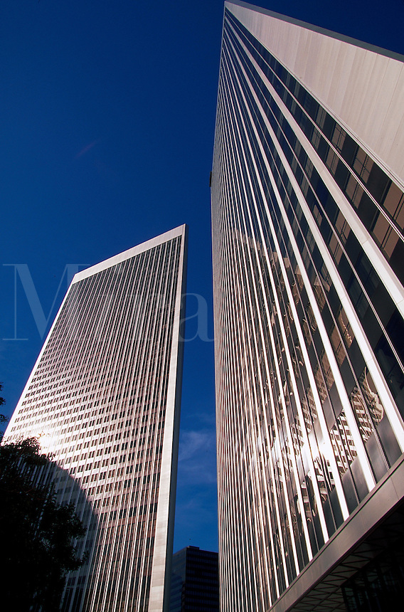 The exterior of the Century Plaza Towers office building in contrast to deep blue sky. Century City, Los Angeles, California.