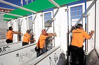 Stewards si preparano ad aprire i cancelli del prefiltraggio per fare entrare i fans di Bruce Springsteen allo stadio Olimpico, Roma, 19 luglio 2009, in occasione del concerto della rockstar statunitense..UPDATE IMAGES PRESS/Riccardo De Luca