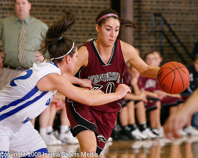 MITCHELL, SD - FEBRUARY 6 -- Leslie Foral #30 of Morningside College dribbles around Sarah Mortenson #22 of Dakota Wesleyan in the first half of their game Wednesday evening at the Corn Palace.