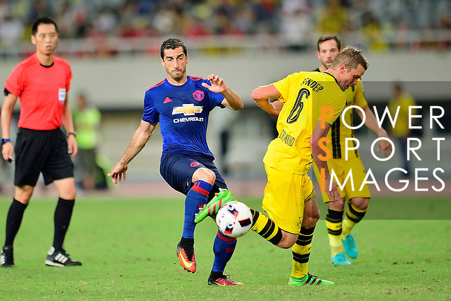 Manchester United midfielder Henrikh Mkhitaryan (l) and Borussia Dortmund midfielder Sven Bender (r) during the International Champions Cup China 2016, match between Manchester United vs Borussia  Dortmund on 22 July 2016 held at the Shanghai Stadium in Shanghai, China. Photo by Marcio Machado / Power Sport Images