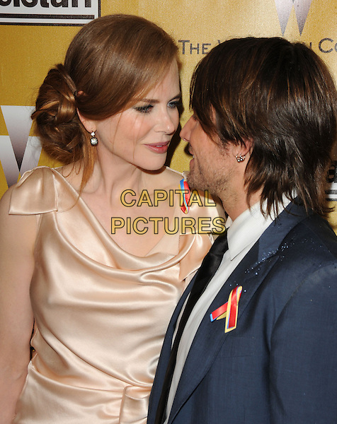 NICOLE KIDMAN & KEITH URBAN.At Weinstein Company Post Golden Globe Party held at Bar210 & Plush Ultra Lounge in Beverly Hills, California, USA. January 17th, 2010                                                                   globes half length pink beige silk satin blue jacket profile married husband wife.CAP/DVS.©Debbie VanStory/Capital Pictures