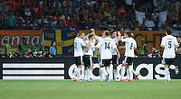 FUSSBALL  EUROPAMEISTERSCHAFT 2012   VORRUNDE Niederlande - Deutschland       13.06.2012 Deutscher Torjubel nach dem 1:0 vor einer Adidas Werbebande