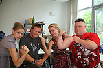 As The World Turns' Marnie Schulenburg - Frankie - Meredith Hagner - Troy show off their muscles at the 12th Annual SoapFest - Painting Party to benefit Marco Island YMCA, theatre program & Art League of Marco Island on May 15, 2010 on Marco Island, FLA. (Photo by Sue Coflin/Max Photos)