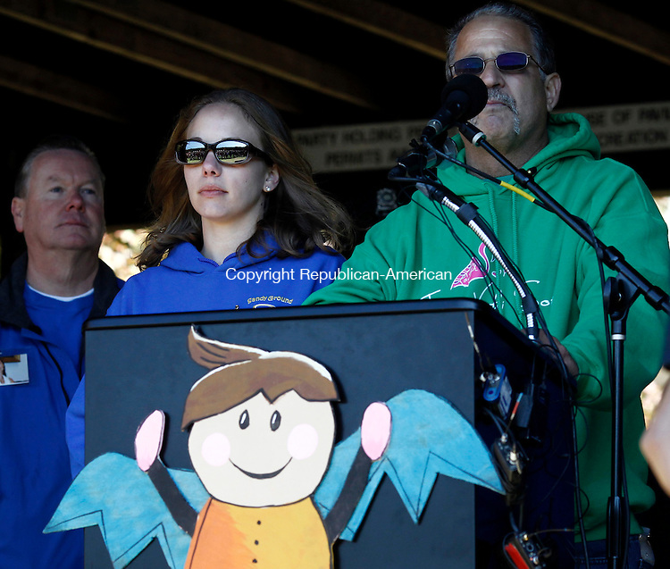 WATERTOWN, CT- 05 October 2014-100514CM01-  Carlos Soto says a few words during a Playground dedication by The Where Angels Play Foundation's at Veterans Memorial Park in Watertown on Sunday. The playground memorial is for Sandy Hook principal Dawn Lafferty Hochsprung who died during the Sandy Hook school shooting. Carlos' daughter, Victoria Soto, 27, was a first grade teacher at Sandy Hook Elementary who died in the school shooting trying to protect her students.  Looking on next to Soto, is Tina Hassigner, daughter of Hochsprung.   Christopher Massa Republican-American