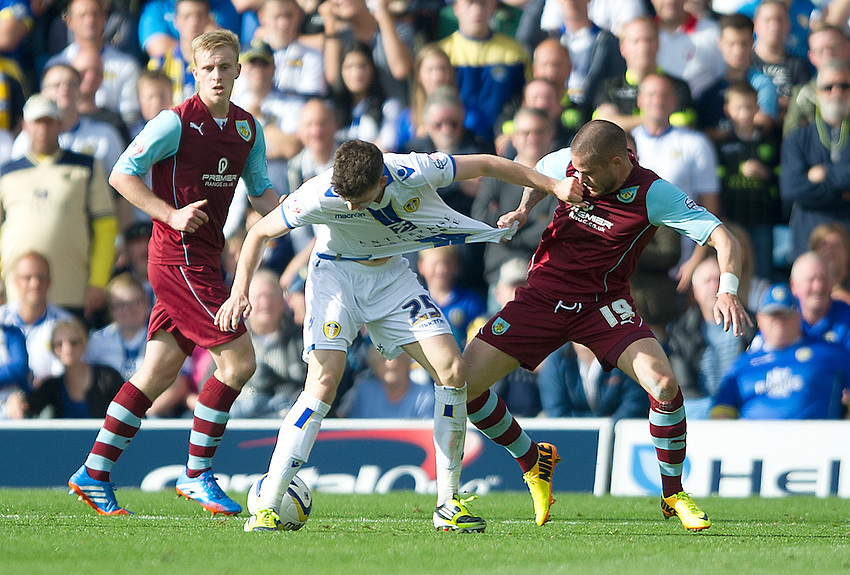 Shirt grabbing by Leeds United's Sam Byram and Burnley's Michael Kightly<br /> <br /> Photo by Stephen White/CameraSport<br /> <br /> Football - The Football League Sky Bet Championship - Leeds United v Burnley - Saturday 21st September 2013 - Elland Road - Leeds<br /> <br /> &copy; CameraSport - 43 Linden Ave. Countesthorpe. Leicester. England. LE8 5PG - Tel: +44 (0) 116 277 4147 - admin@camerasport.com - www.camerasport.com