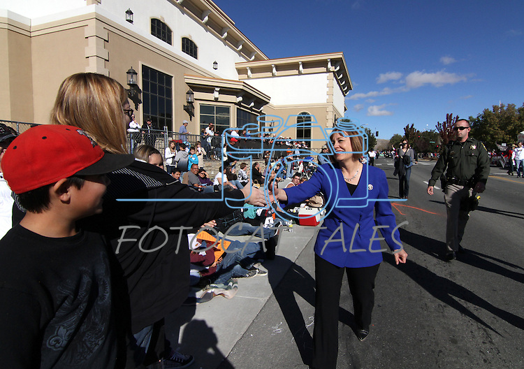 U.S. Senate candidate Sharron Angle talks with people along Carson Street on Saturday during the Nevada Day parade in Carson City, Nev. .Photo by Cathleen Allison