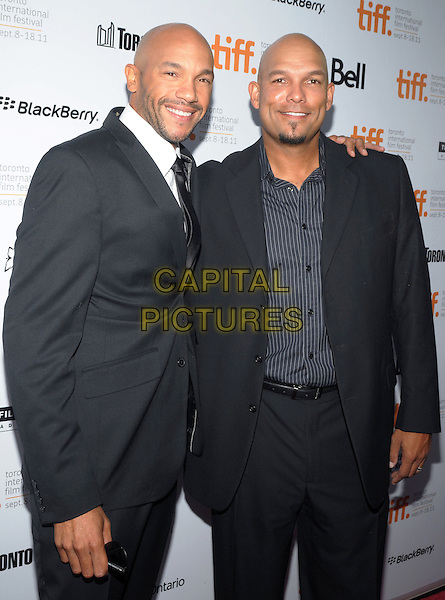 "Stephen Bishop & David Justice.""Moneyball"" Premiere - 2011 Toronto International Film Festival held at Roy Thomson Hall, Toronto, Ontario, Canada .9th September 2011..half length black suit tie arm around .CAP/ADM/BPC.©Brent Perniac/AdMedia/Capital Pictures."