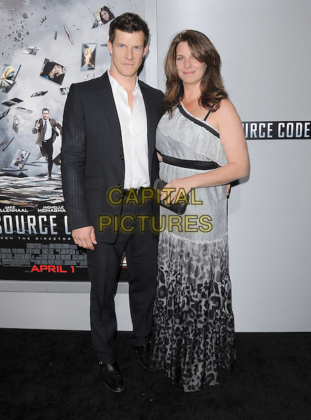 "ERIC MABIUS & IVY.L.A Premiere of ""Source Code"" held at The Cinerama Dome in Hollywood, California, USA..March 28th, 2011.full length suit shirt grey gray maxi dress married husband wife white black.CAP/RKE/DVS.©DVS/RockinExposures/Capital Pictures."