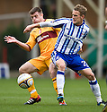 MOTHERWELL'S STEVEN JENNINGS  AND KILMARNOCK'S DEAN SHIELS CHALLENGE FOR THE BALL