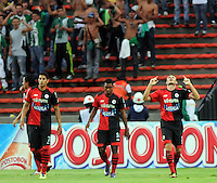 MEDELLêN -COLOMBIA-09-11-2013.  Gonzalo Pizzichillo (Der) del Cucuta Deportivo celebra su gol  contra el Atletico Nacional durante partido de la 18 fecha del la Liga Postob—n 2013-1 realizado en el estadio Atanasio Girardot de Medell'n./  Gonzalo Pizzichillo (R) of Cucuta Deportivo celebrates his goal against Atletico Nacional during the 18th game of the League Postob—n date 2013-1 made ??in the Atanasio Girardot stadium in Medellin.  Photo:VizzorImage / Luis Rios / Stringer