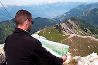 Liechtenstein  Malbun  June 2008.Small town high in the Alpine (southeastern)..Fürstin-Gina-Weg' (Princess Gina memorial trail)..Tourist looks at the map on top of the Augstenberg (2359 m),.to the left valley of the Rhine...