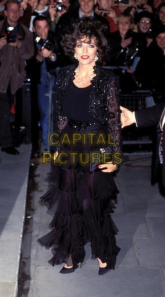 JOAN COLLINS.black tiered skirt.Ref: 437 .www.capitalpictures.com.sales@capitalpictures.com.© Capital Pictures