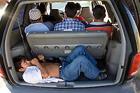 An illegal immigrant lays in the back of a minivan loaded with nine people that was stopped along  I-17 north of Phoenix, Ariz.  The group was taken into custody by Maricopa County Sheriff's deputies. Photo by Pat Shannahan