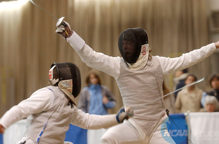 28 MAR 2004: Boaz Ellis (left) of Ohio State University misses a strike against Cory Werk (right) of Yale University during the Men's Foil event at the 2004 NCAA Division 1 Fencing Championships held at Gosman Athletic Center on the campus of Brandies University in Waltham, MA. Ellis placed first in the competition to win the national title. Jim Mahoney/NCAA Photos.