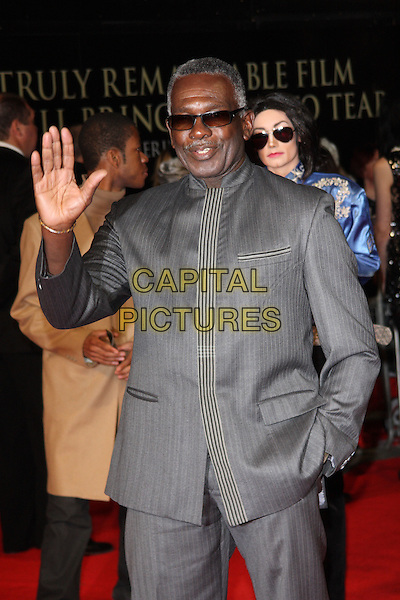 "Rudolf Walker.The ""Michael Jackson : The Life Of An Icon"" UK premiere, Empire cinema, Leicester Square, London, England..2nd November 2011.half length grey gray suit sunglasses shades hand in pocket palm waving.CAP/ROS.©Steve Ross/Capital Pictures."