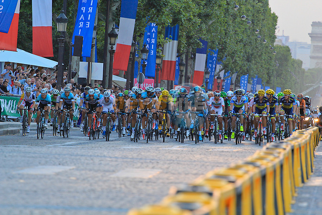 The peloton including Race Leader Yellow Jersey Christopher Froome (GBR) Sky Procycling on the Champs-Elysees during the Final Stage 21 of the 100th Edition of the 2013 Tour de France from Versailes to Paris Champs-Elysees. 21st July 2013.<br /> (Photo:Thomas van Bracht / Peloton Photos/www.newsfile.ie)
