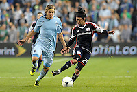 Lee Nguyen (24) New England midfielder gets ahead of Sporting KC defender Chance Myer... Sporting Kansas City defeated New England Revolution 3-0 at LIVESTRONG Sporting Park, Kansas City, Kansas.