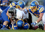 BROOKINGS, SD - OCTOBER 11:  Sean Bernard #2 from Missouri State is wrapped up by Nick Mears #42, Landon Schultz #93 and Melvin Taveras #1 from South Dakota State in the first half of their game Saturday evening at Coughlin Alumni Stadium in Brookings. (Photo/Dave Eggen/Inertia)