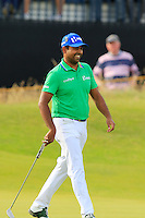 Anirban Lahiri (IND) sinks his birdie putt on the 14th green during Thursday's Round 1 of the 145th Open Championship held at Royal Troon Golf Club, Troon, Ayreshire, Scotland. 14th July 2016.<br /> Picture: Eoin Clarke | Golffile<br /> <br /> <br /> All photos usage must carry mandatory copyright credit (&copy; Golffile | Eoin Clarke)