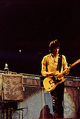 "Chicago, Illinois<br /> July 23, 1975<br /> USA<br /> <br /> Guitarist Keith Richards of the Rolling Stones performs live at Chicago Stadium during the band's ""Rolling Stones Tour of the Americas '75"".<br /> <br /> This was the Stones first tour with new guitarist Ronnie Wood, after Mick Taylor left the band. The Stones, with their usual act freshly aided by theatrical stage props  including a giant inflatable phallus (nicknamed 'Tired Grandfather' by the band, since it sometimes malfunctioned) and, at the Chicago shows, an unfolding lotus flower-shaped stage that Charlie Watts had conceived.<br /> <br /> The band was composed of  Mick Jagger - vocals, guitar, harmonica, Keith Richards - guitar, vocals, Bill Wyman - bass guitar, and Charlie Watts - drums, percussion. <br /> <br /> Additional musicians included: Ronnie Wood - guitar, backing vocals, Ian Stewart - piano, Billy Preston - keyboards, vocals and Ollie Brown - percussion."