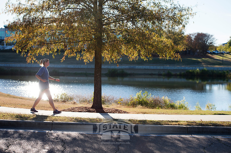 Jogger at Chadwick Lake.<br />  (photo by Megan Bean / &copy; Mississippi State University)