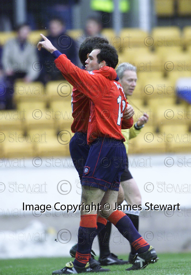 3rd March 2001    Copyright Pic : James Stewart .Ref :                           .File Name : stewart14-st johnstone v dundee.JAVIER ARTERO IS CONGRATULATED BY JUAN SARA AFTER HE SCORES DUNDEE'S THIRD GOAL.......Payments to :-.James Stewart Photo Agency, Stewart House, Stewart Road, Falkirk. FK2 7AS      Vat Reg No. 607 6932 25.Office : +44 (0) 1324 630007        Mobile : 07721 416997.Fax     : +44 (0) 1324 630007.E-mail : jim@jspa.co.uk.If you require further information then contact Jim Stewart on any of the numbers above.........