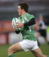 Irish centre Eoin O'Malley on the attack during the Division A clash with Scotland in the IRB U19 World Championship at Ravenhill, Belfast. Result 12-13 to Ireland.