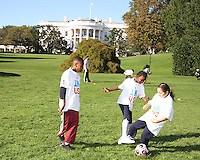 "Kids in front of the White House during a  D.C United clinic in support of first lady Michelle Obama's ""Let's Move"" initiative on the White House lawn, in Washington D.C. on October 7 2010."