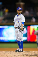 Durham Bulls relief pitcher Jose Dominguez (36) looks to his catcher for the sign against the Charlotte Knights at BB&T BallPark on July 22, 2015 in Charlotte, North Carolina.  The Knights defeated the Bulls 6-4.  (Brian Westerholt/Four Seam Images)