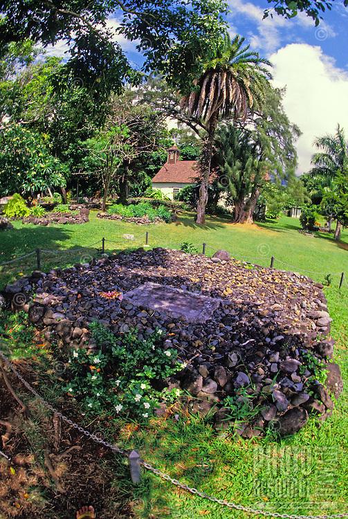 Famous aviator Charles Lindbergh's gravesite near Hana, Maui. Palapala Hoomau Church is in the background.