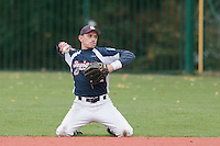 23 October 2010: Fabien Proust of Savigny throws the ball to first base during Savigny 8-7 win (in 12 innings) over Rouen, during game 3 of the French championship finals, in Rouen, France.