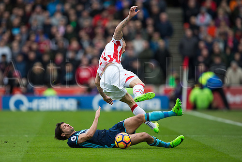 March 4th 2017,  bet365 Stadium, Stoke, England; EPL Premier League football, Stoke City versus Middlesbrough; Middlesbrough's George Friend tackles Stoke's Marko Arnautovic
