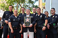 LOS ANGELES, CA. July 31, 2019: Stacy Keach & LAPD Captain Cory Palka & Hollywood Team at the Hollywood Walk of Fame Star Ceremony honoring Stacy Keach.<br /> Pictures: Paul Smith/Featureflash