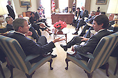 United States President George W. Bush meets with President Jose Maria Aznar of Spain and senior staff in the Oval Office of the White House in Washington, D.C. on Wednesday, November 28, 2001.  Also visible in the photo are U.S. Secretary of State Colin Powell and National Security Advisor Condoleezza Rice..Mandatory Credit: Eric Draper - White House via CNP.