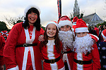 Jackie O'Brien, Olivia Rachel Smith and Aine O'Brien at the Drogheda Christmas Bonanza santa parade<br /> Picture: Fran Caffrey www.newsfile.ie