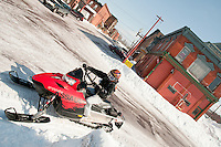 Snowmobiles in downtown Calumet Michigan.