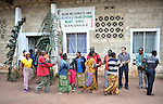 Worshippers greet each other following a worship service at a United Methodist church in Kananga, DR Congo.