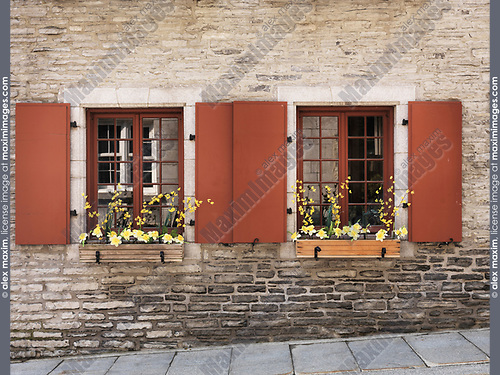Closeup of windows with flowers and shutters of a historic house in Old Quebec City, architectural details. Quebec, Canada. Ville de Québec.