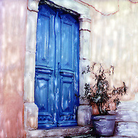Blue door with his friend the blue urn and the wilting plant. Blue seems to be the ever present color in the Greece islands.