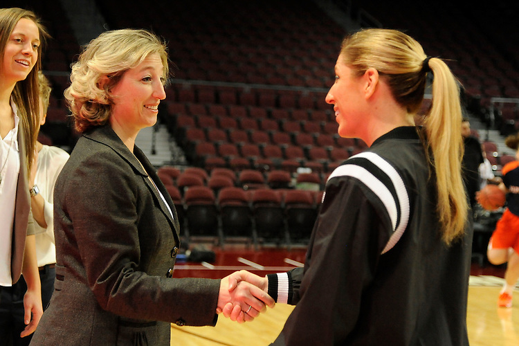March 6, 2014; Las Vegas, NV, USA; Santa Clara Broncos head coach Jennifer Mountain (left) shakes hands with referee against the Pepperdine Waves before the game of the WCC Basketball Championships at Orleans Arena. The Waves defeated the Broncos 80-74.