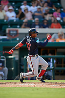 Atlanta Braves center fielder Cristian Pache (77) hits a double during a Grapefruit League Spring Training game against the Detroit Tigers on March 2, 2019 at Publix Field at Joker Marchant Stadium in Lakeland, Florida.  Tigers defeated the Braves 7-4.  (Mike Janes/Four Seam Images)