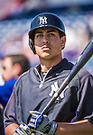 11 March 2014: New York Yankees outfielder Ramon Flores awaits his turn in the batting cage prior to a Spring Training game against the Washington Nationals at Space Coast Stadium in Viera, Florida. The Nationals defeated the Yankees 3-2 in Grapefruit League play. Mandatory Credit: Ed Wolfstein Photo *** RAW (NEF) Image File Available ***
