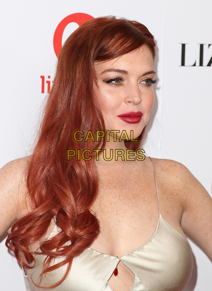 "Lindsay Lohan.Lifetime presents ""Liz & Dick"" - Los Angeles Premiere Held At Beverly Hills Hotel, Beverly Hills, California, USA..November 20th, 2012.headshot portrait dyed red hair lipstick   silk satin white cream cut out away .CAP/ADM/KB.©Kevan Brooks/AdMedia/Capital Pictures."