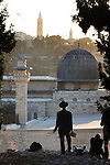 Religious Jews are seen praying at sunrise, during the Birkat Hama prayer at the the old city of Jerusalem. The prayer, which celebrates creation, is said once every 28 years all over Israel on high points,  allegedly at the exact moment when the solar system is alligned exactly as it was at the moment of the creation of the Universe. Photo By : Eliyahu Ben Igal / JINI