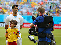 Luis Suarez of Uruguay is the focus of the television cameras as the teams line up before kick off