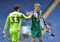 Blackburn Rovers' Christian Walton shakes hands with Reading's Rafael Cabrel at the end of the game.  But should they be doing that?<br /> <br /> Photographer Dave Howarth/CameraSport<br /> <br /> The EFL Sky Bet Championship - Blackburn Rovers v Reading - Saturday 18th July 2020 - Ewood Park - Blackburn<br /> <br /> World Copyright © 2020 CameraSport. All rights reserved. 43 Linden Ave. Countesthorpe. Leicester. England. LE8 5PG - Tel: +44 (0) 116 277 4147 - admin@camerasport.com - www.camerasport.com