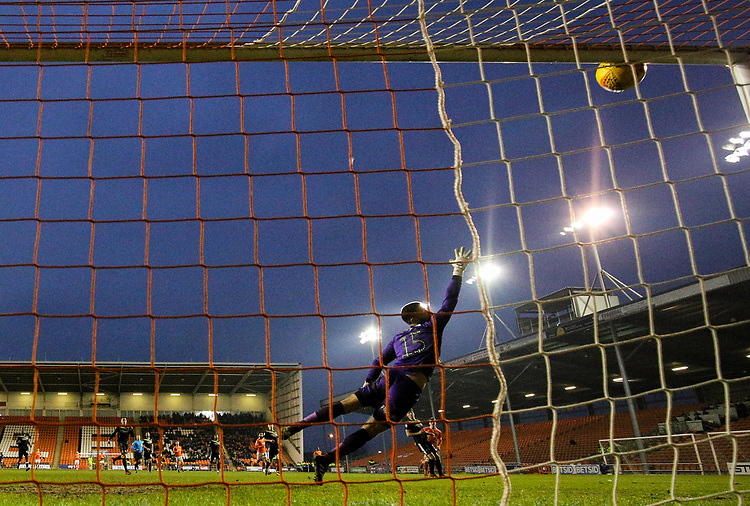 Shrewsbury Town's Steve Arnold is beaten by the shot from Blackpool's Chris Long, which hits the bar<br /> <br /> Photographer Alex Dodd/CameraSport<br /> <br /> The EFL Sky Bet League One - Blackpool v Shrewsbury Town - Saturday 19 January 2019 - Bloomfield Road - Blackpool<br /> <br /> World Copyright &copy; 2019 CameraSport. All rights reserved. 43 Linden Ave. Countesthorpe. Leicester. England. LE8 5PG - Tel: +44 (0) 116 277 4147 - admin@camerasport.com - www.camerasport.com