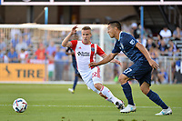 San Jose, CA - Saturday June 17, 2017: Tommy Thompson, Roger Espinoza during a Major League Soccer (MLS) match between the San Jose Earthquakes and the Sporting Kansas City at Avaya Stadium.